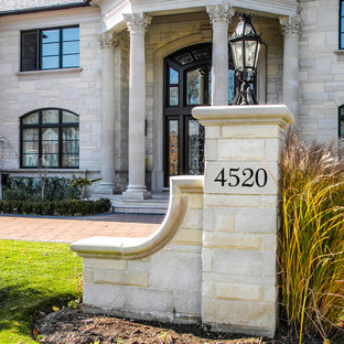 Traditional gray stone exterior home idea in Chicago
