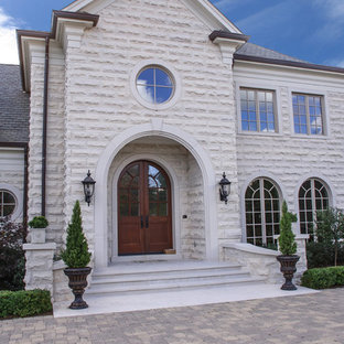 Elegant stone exterior home photo in Chicago