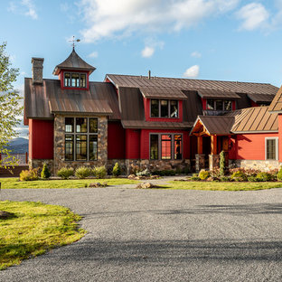 Country red two-story mixed siding exterior home photo in Burlington with a metal roof