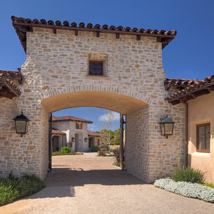 Mediterranean house exterior in San Francisco with stone cladding and a tiled roof.