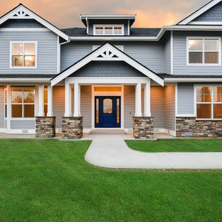 Transitional blue two-story exterior home photo in Seattle