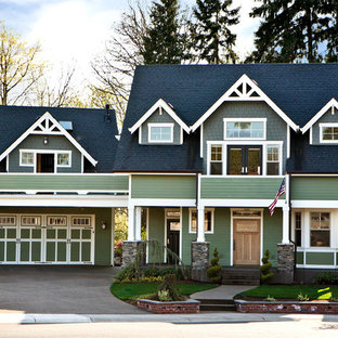 Example of a classic green gable roof design in Portland