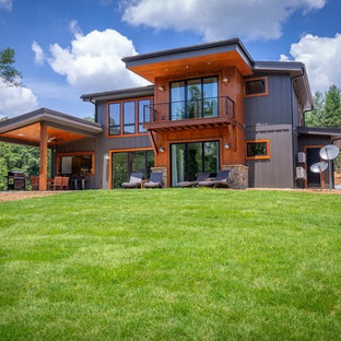 Mid-sized industrial brown two-story wood house exterior idea in Chicago with a shed roof and a metal roof