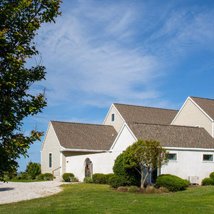 Danish green concrete fiberboard exterior home photo in Other with a shingle roof