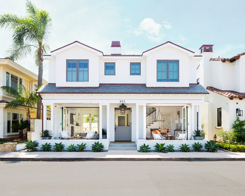Example Of A Coastal White Two Story Exterior Home Design In Orange County  With A