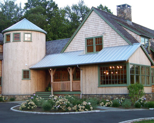Marvelous Example Of A Mountain Style Stone Gable Roof Design In New York