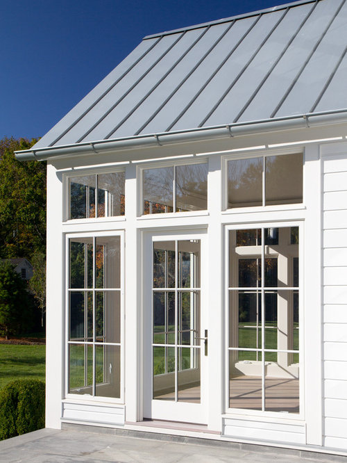 Example Of A Large Country White Two Story Vinyl Gable Roof Design In New  York