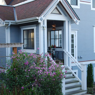 Example of a large ornate gray two-story wood exterior home design in Seattle with a shingle roof