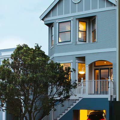 Inspiration for a large victorian three-story wood gable roof remodel in San Francisco
