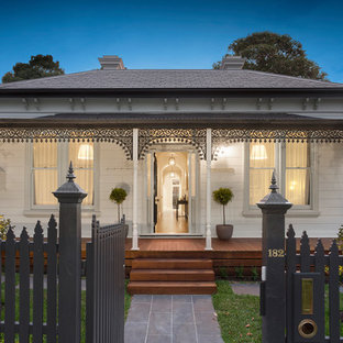 Design ideas for a traditional one-storey white house exterior in Melbourne with a hip roof and a shingle roof.