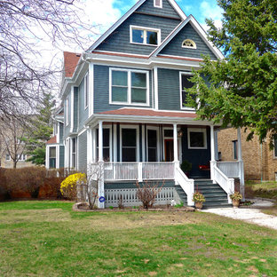 Mid-sized victorian gray three-story concrete fiberboard exterior home idea in Chicago with a shingle roof