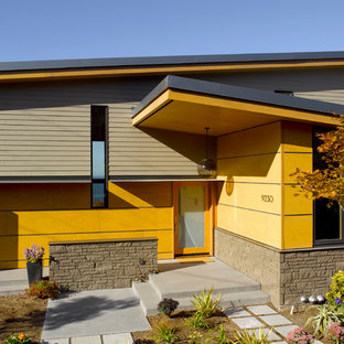 Inspiration for a 1960s yellow exterior home remodel in Seattle