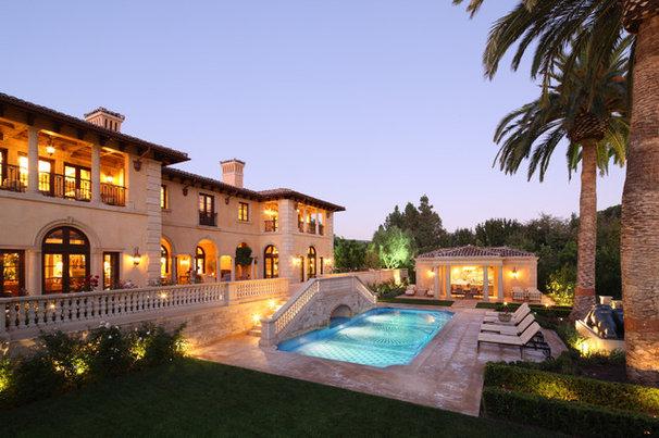 Mediterranean Exterior by Richard Manion Architecture Inc.