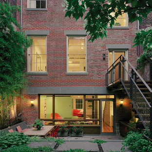 Design ideas for a red traditional brick exterior in New York.