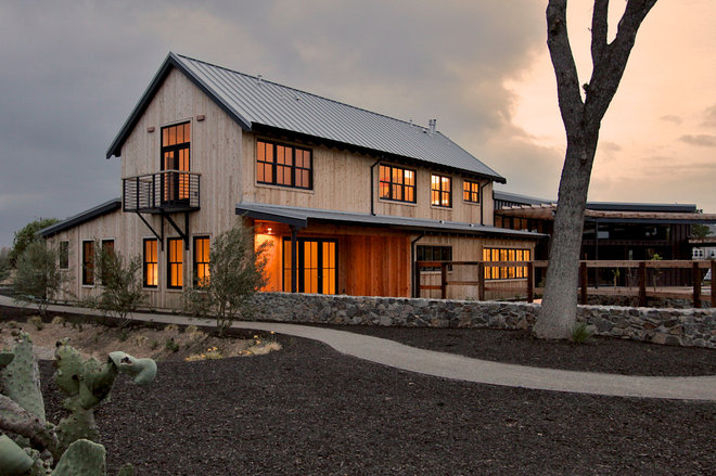 Transitional Exterior by Mikiten Architecture