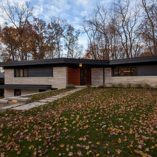 Large midcentury modern gray two-story concrete fiberboard exterior home idea in Indianapolis