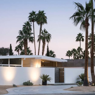 Inspiration for a mid-sized 1960s white one-story stucco gable roof remodel in Los Angeles