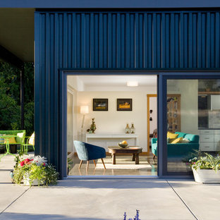 Contemporary blue one-story metal flat roof idea in Seattle