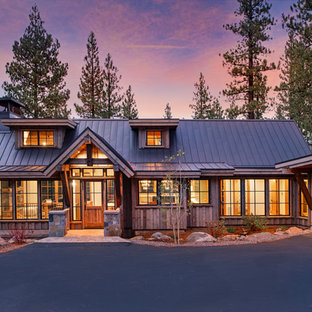 Example Of A Mid Sized Mountain Style Brown Two Story Wood Gable Roof Design