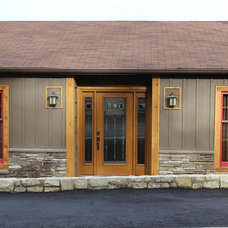 Rustic Exterior by VPC Builders, LLC