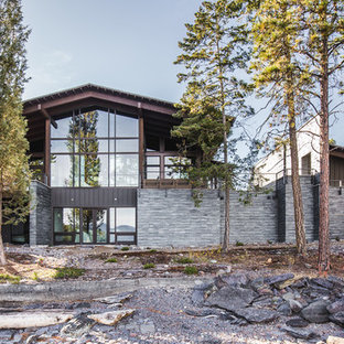 Mid-sized mountain style gray two-story mixed siding exterior home photo in Other