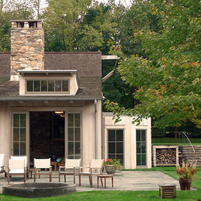 Example of a classic wood exterior home design in New York