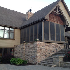Traditional Exterior by Landmark Landscape and Construction
