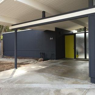 Inspiration pour une façade en bois bleue vintage.