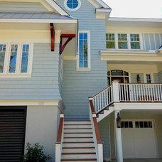 Beach Style Exterior by DLB Custom Home Design