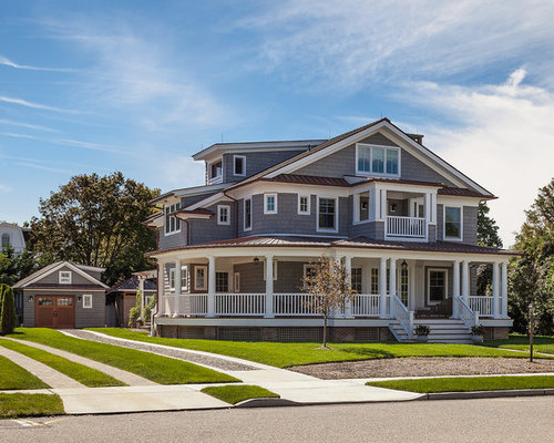 This is an example of a large victorian exterior in other with three - Certainteed Granite Gray Vinyl Siding Home Design Ideas