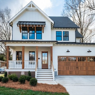 Inspiration for a cottage white two-story exterior home remodel in Charlotte with a shingle roof