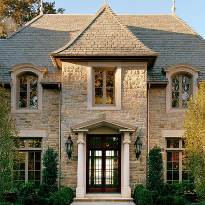Inspiration for a timeless beige two-story stone exterior home remodel in New York
