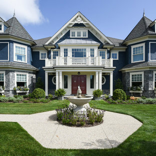 Example of an ornate blue mixed siding house exterior design in New York with a shingle roof