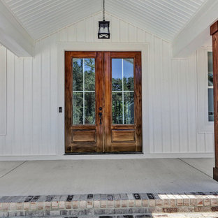 Country white two-story vinyl exterior home photo in Richmond with a shingle roof