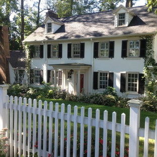 Large traditional white three-story stucco gable roof idea in Philadelphia