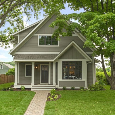 Example of a mid-sized classic gray two-story vinyl exterior home design in Minneapolis