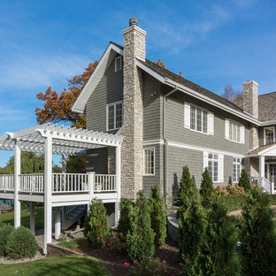 Large beach style gray two-story wood gable roof idea in Minneapolis with a shingle roof