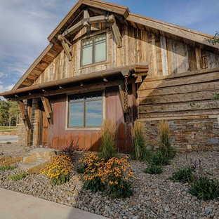 Inspiration for a rustic brown metal exterior home remodel in Other with a metal roof