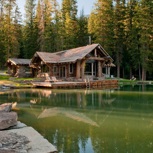 Mountain style brown one-story wood exterior home photo in Other with a metal roof