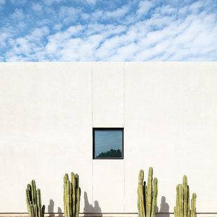Southwest white one-story stucco flat roof photo in Phoenix