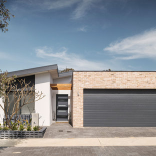 Design ideas for a mid-sized contemporary one-storey brick multi-coloured house exterior in Perth with a flat roof and a metal roof.