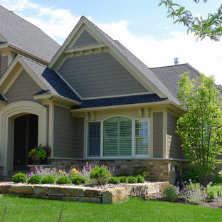 Inspiration for a timeless beige two-story concrete fiberboard gable roof remodel in Minneapolis