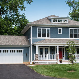 Example of a large arts and crafts blue two-story vinyl exterior home design in DC Metro