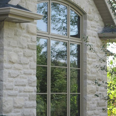 Traditional Exterior by Ridley Windows & Doors