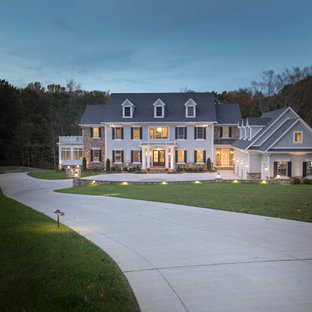 Huge transitional gray three-story wood exterior home photo in Baltimore with a shingle roof