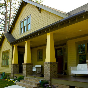 Arts and crafts wood exterior home photo in Raleigh