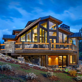 Inspiration for a large rustic two-story exterior home remodel in Denver