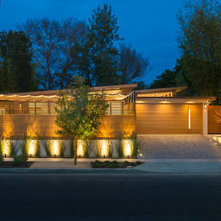 Mid-sized contemporary brown one-story wood exterior home idea in Los Angeles with a shed roof