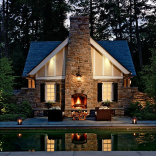 Small traditional beige one-story stone exterior home idea in New York with a shingle roof