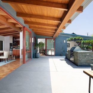 Example Of A Mid Sized 1950s Gray One Story Wood Exterior Home Design In